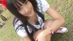 Cute Asian teen girl is a tease outdoors